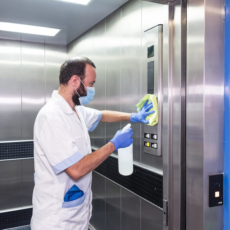 cleaning staff performing disinfection and hygiene work in hospital facilities